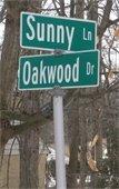 Sunny & Oakwood street sign